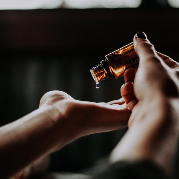 Woman applying essential oils
